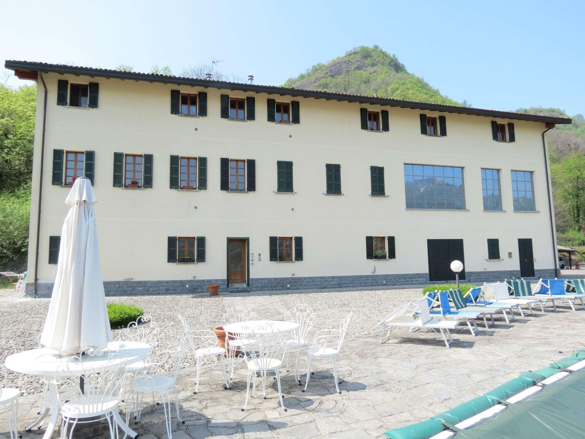 Bilocale Como Via Castel Baradello 1