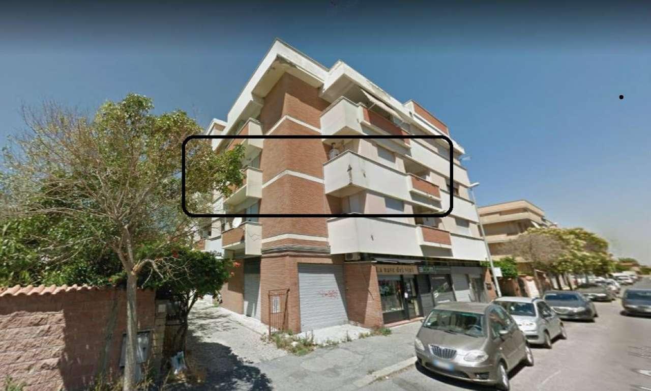 Asta, Fiumicino via delle Sogliole, secondo piano 130 mq, angolare, 3 balconi, buono stato