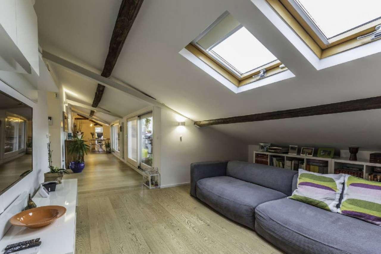 mansarda terrazza in falda 2 camere 2 bagni studio lavanderia cantina 2 posti auto ascensore